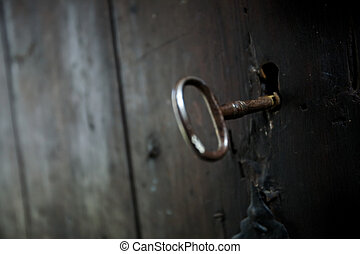 Skeleton Key - A skeleton key in a black door and lock...