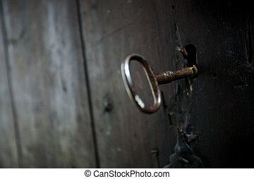 Skeleton Key - A skeleton key in a black door and lock....