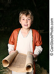 Boy reading a scroll - Boy reading from a gevil parchment...