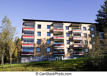 Apartment Building - An apartment building in bright...