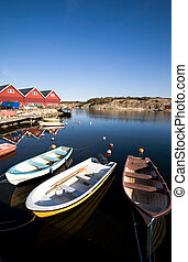 Small Boast at Dock - A group of small row boats tied to the...