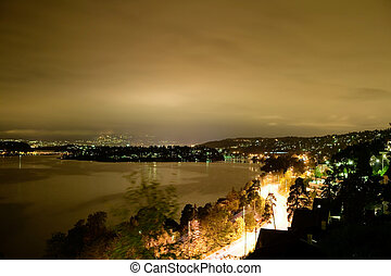 Night Cityscape - View of Oslo and the Oslo fjord at night -...