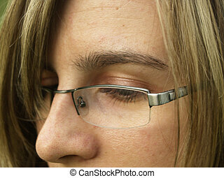 Girls face - Beauty young womens face. glasses and blond...