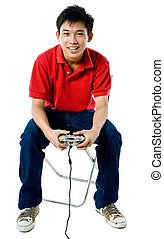 Gaming - Young teenage boy playing a remote controlled game