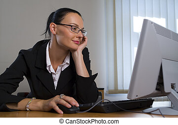 Happy At Work - An attractive female executive happily...