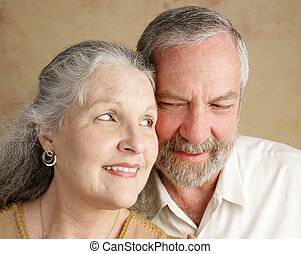 Eye Contact - Portrait of a happily married mature couple...