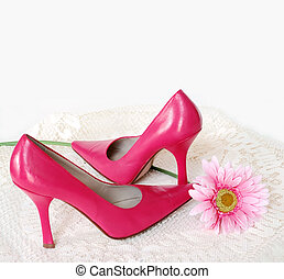Her First Heels - a pair of hot pink high heel shoes sitting...