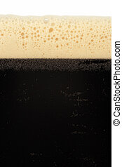 Stout beer - A macro image of a glass of stout beer or...