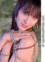 Erotic girl - Erotic brunette girl with chain on green...