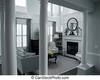 Interior Design - pillars leading into a living room with...
