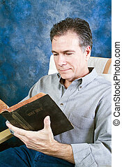 Quiet Time - A man with a relaxed, pleasant expression on...