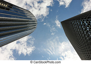 competing for success - dramatic view of skyscrapers in...