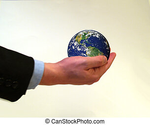 holding planet earth - Businessman holding planet earth in...