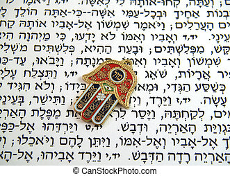 Hamsa kabbalah good luck charm on Hebrew bible