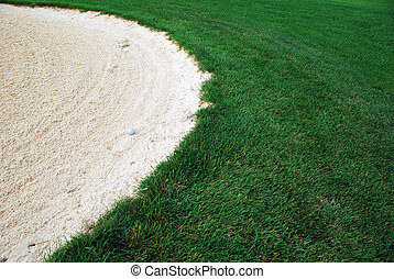 Golf Ball the sand trap - Golf Ball in the sand trap with...
