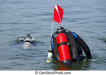 Divers Going Down - A pair of divers diving into Lake...