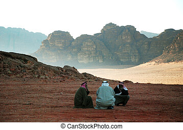 3 arab men in desert - Wadi Rum, Jordan