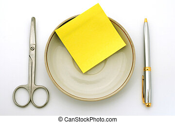 business lunch - pen scisors yellow paper on a white...