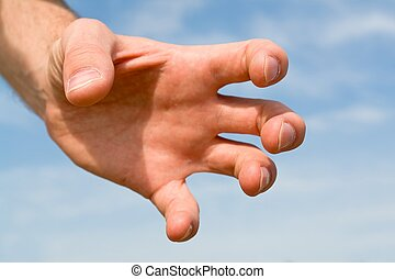 confiscation. hand gesture with blue sky at background