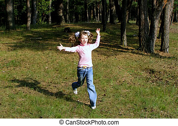running child - fervent child hurries on a lawn near the...