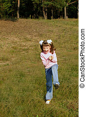 happy child - fervent child hurries on a lawn near the...
