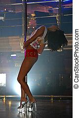 Striptease - The girl dances with a stick. Competitions on...