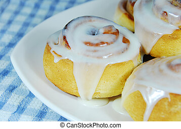Cinnamon Rolls on a plate with checked tablecloth