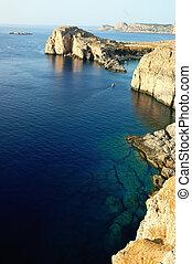 Coastline - Rocky coastline in Lindos bay, Rhodes, Greece.