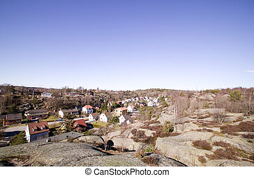 Houses in Rock Valley - A street following a valley in a...