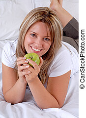 Hotel Guest - Attractive Blond Young Woman Holding An Apple...