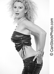 Sexy fatigues - Attractive woman with curly blond hair in a...