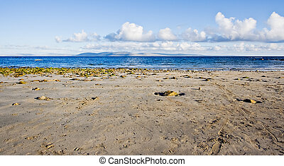 Galway Bay in Ireland. The photo is layered with sand,...