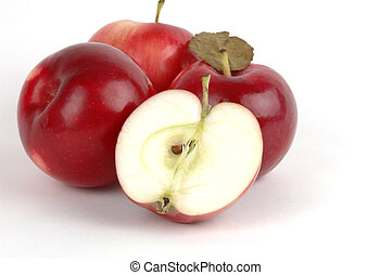 Halved Apple - Ripe red apple cut in half in front of whole...