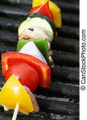 Grilling Kabobs - Grilling a kabob during a summer picnic at...