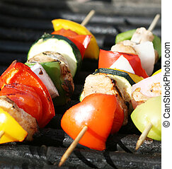Grilling kabobs during a summer picnic at the park