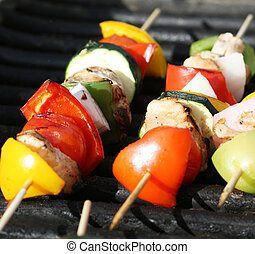 Shishkabobs - Grilling shishkabobs during a summer picnic at...