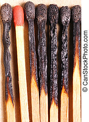 Burnt matches with red match - Burnt matches with one red...