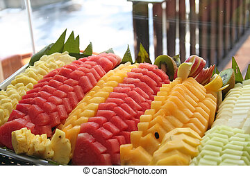Tropical fruits - Platter of cut tropical fruits watermelon...