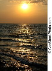 sunset - Sea waves with sunset at background