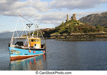 Isle of Skye - A fishing boat returning to harbour after a...
