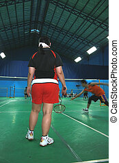 badminton match - badminton doubles match with male and...