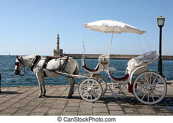 Horse-drawn tax - A horse-drawn taxi on the harbour front at...