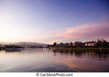 Harbor at Sunset - A boat harbor in the late fall painted in...