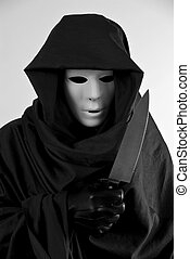 Scary Costume - A man in a scary Halloween costume holding a...