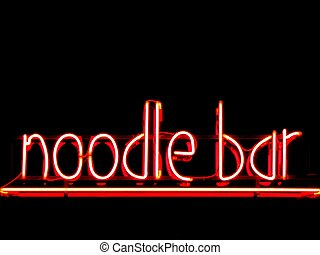 Noodle bar neon sign outside restaurant