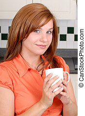 Pretty Redhead Woman - Young Woman At Home In Her Kitchen