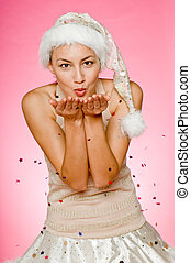 Christmas Kisses - A beautiful mixed race woman blowing...