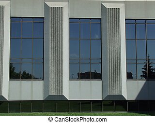 big windows - the side of an office building with big...