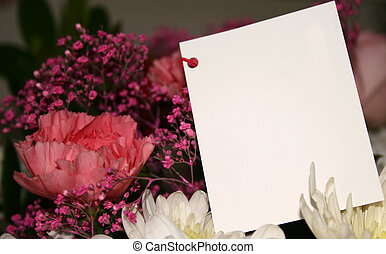 gift of flowers - blank card on a bouquet of flowers