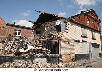 collapsed building - remains of a building which had...